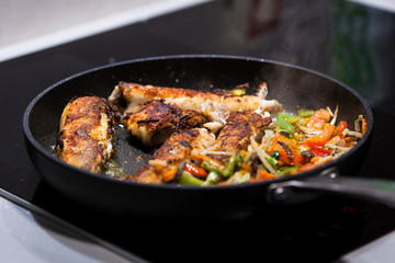 Fish dish - fried fish with vegetables