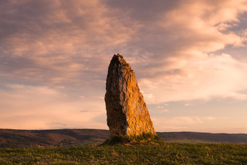 Menhir on the hill at sunset in Morinka in Czech Republic Wall mural