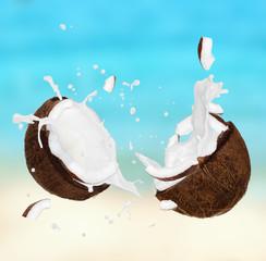 Wall Mural - Coconut with milk splash on the beach