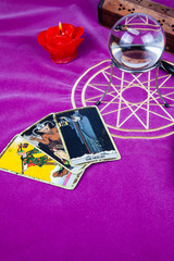 Tarot cards with a magic ball and a candle.
