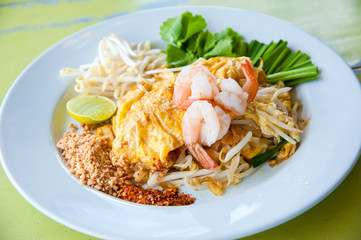 Stir-fried rice noodles with egg and shrimp (Pad Thai)