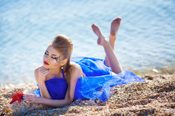 Girl with seashells on the beach