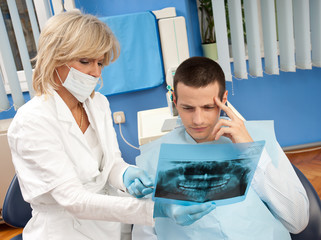 woman dentist with male patient