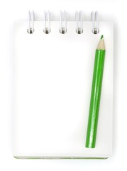 green pencils and notebook on a white background