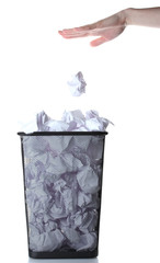 hand going garbage in metal trash bin from paper isolated