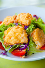 Delicious salad with fish, vegetable and dipping sauce