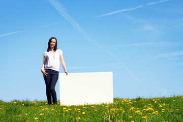 happy smiling woman against blue sky - space for text