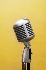 vocal studio microphone over yellow
