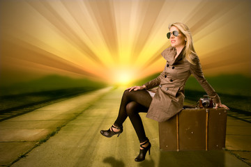 Beautiful blond woman waiting on train, concept of travel