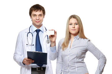 A male doctor showing a card and a patient
