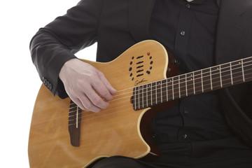 Guitarplayer on white