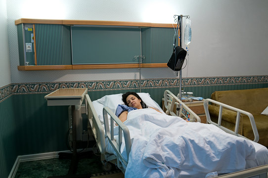 Female patient sleeping at hospital after surgery