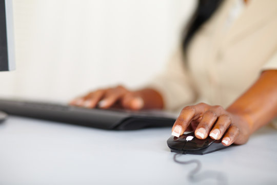 Young woman hands working on computer