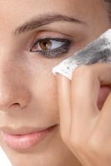 Closeup photo of removing eye makeup