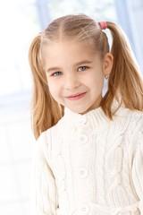 Portrait of cute little girl smiling