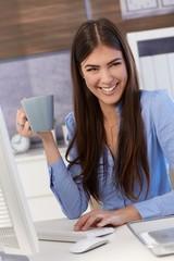 Happy businesswoman with coffee mug