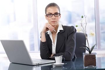 Businesswoman at work having coffee