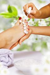 Fototapete - Pedicure in the spa salon in the garden