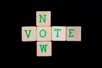 Letters on wooden blocks (now, vote)