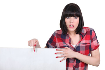 Impatient woman pointing to a blank sign