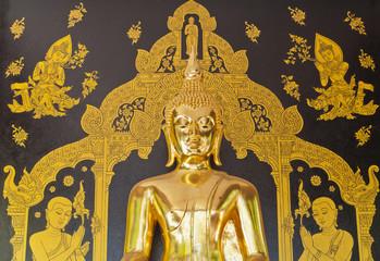 gold buddha on black wall