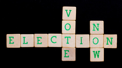 Letters on wooden blocks (vote, election, now)
