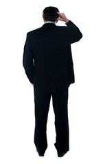Rear view of corporate person thinking