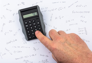 person calculating on a pocket calculator