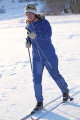 girl with tense face runs on skis