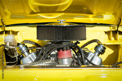Wall mural air filter system in the engine bay of a high performance car