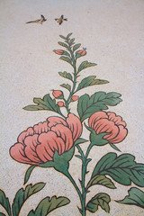 Paintings of flowers on a wall in Chinese temple
