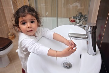 Little girl is washing hands