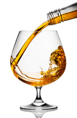 Fototapete - The glass with splashes brandy