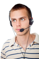 young man talking on headset against a white background