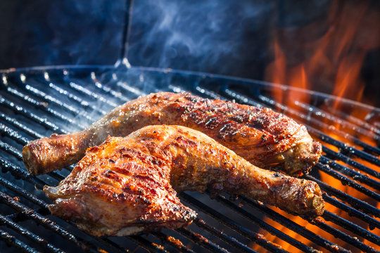 Roast chicken leg on grill