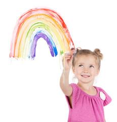 Little girl paints rainbow on window