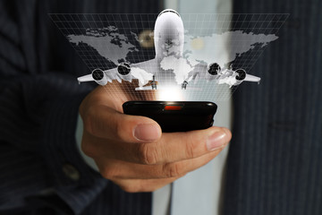 business man hand use mobile phone streaming travel around the w