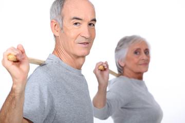 Senior couple doing gymnastics