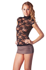 Cute blond smiling woman dressed in a skirt and transparent blou