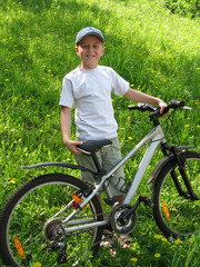 smiling boy on bicycle