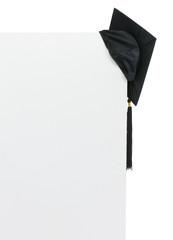 Graduation cap on blank billboard