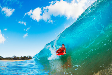 Wall Mural - Boogie Boarder in the Barrel Riding Blue Ocean Wave