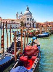 Foto op Canvas Gondolas Gondolas with Santa Maria della Salute in Venice, Italy