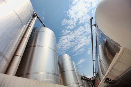 Silver silos and tank - industrial infrastructure