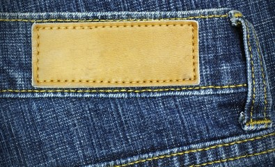 jeans label sewed on a blue jeans, used as background for your t