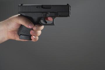 Holding Gun Gray Background