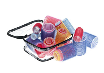 Case of hair rollers on white