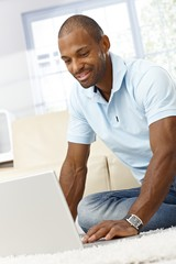Smiling man with laptop computer