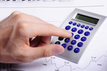 Obraz liczenie na kalkulatorze - fototapety do salonu