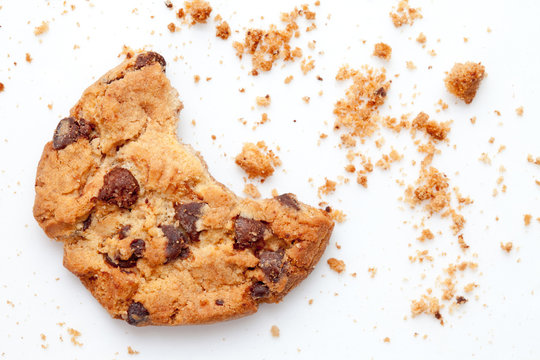 Close up of an half eaten cookie with crumb